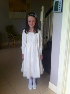 Heather Smyth, 8, wearing the shoes her grandmother, Christina, had bought her for her First Communion day.