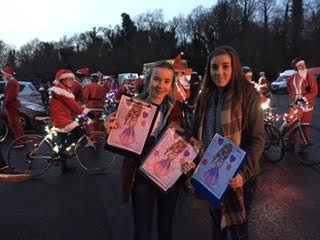 Molly and her sister Rose at Santa cycle in Phoenix Park, Dublin, getting the petition signed