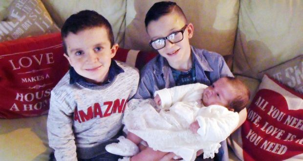 Brothers Mark (12) and Evan (8), who died in the pier tragedy, cradling their baby sister, Rioghnach-Ann