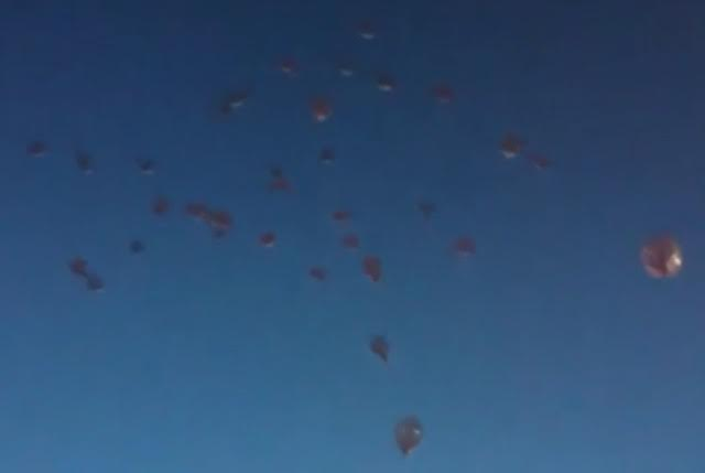 Balloons released by the family to remember Willie and Ana