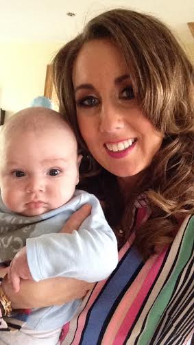Maria and baby Rhys at home relaxing