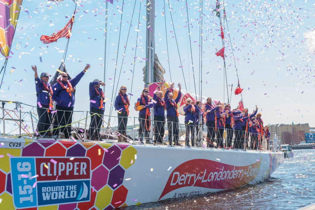The crew of the Clipper Round the World Yacht  Derry-Londonderry-Doire wave farewell to their home port during their departure from Derry-Londonderry in Northern Ireland as they start race 13. Picture Martin McKeown/Clipper-ventures.