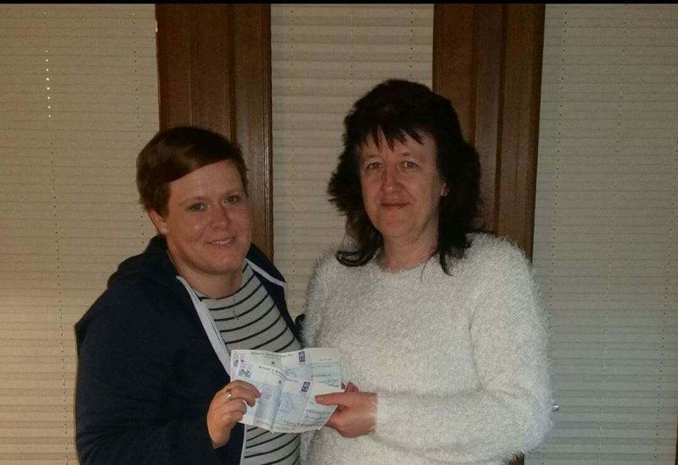 Fundraiser Maria (left) hands over a cheque to Colette O Callaghan (right) of HART