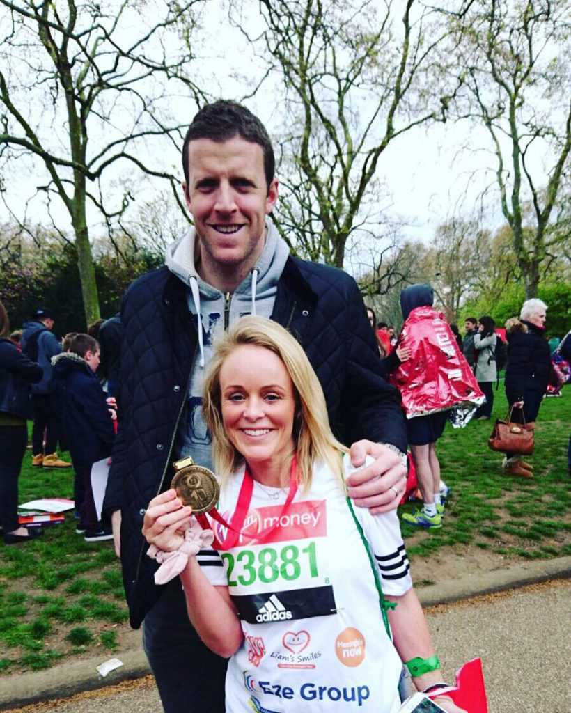 Stronger than ever: Becky Doyle with husband Colin as she completed the London Marathon.