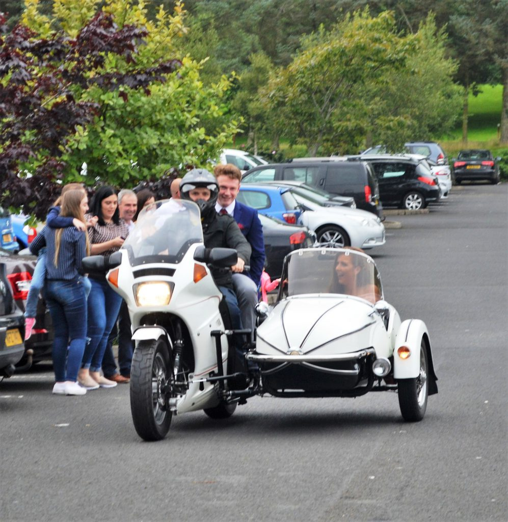 Motoring along:  Ultan and Chloe arrive in style