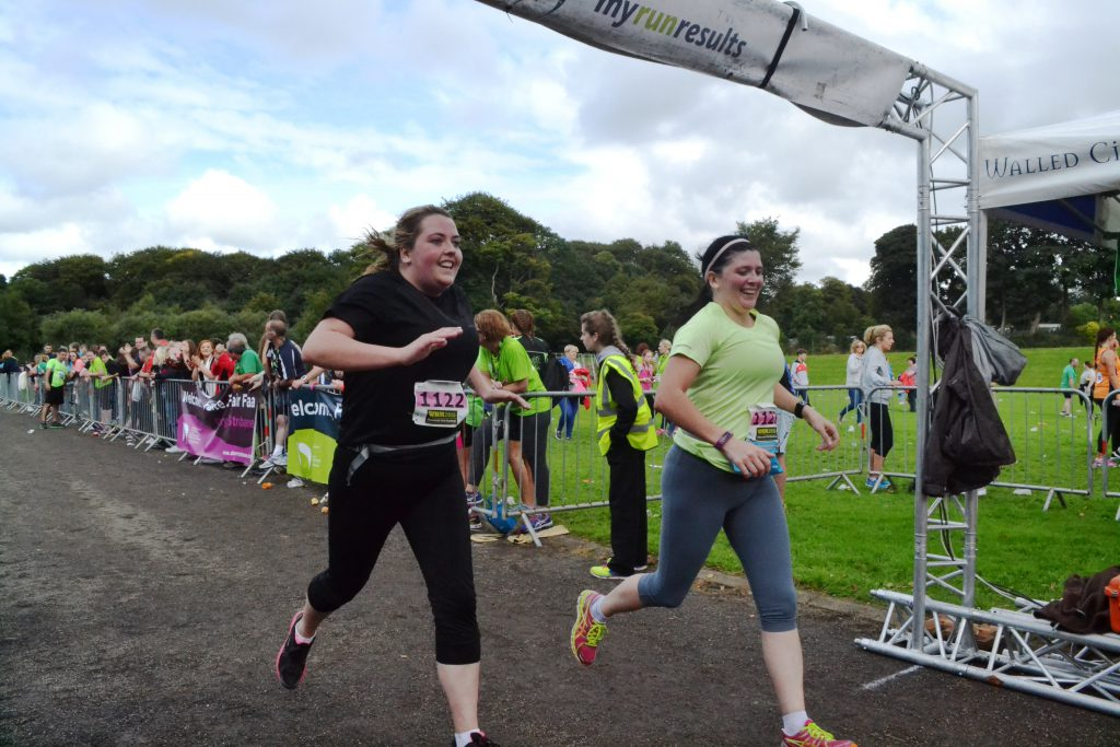 Victory: Maria and Niamh hit the finish line