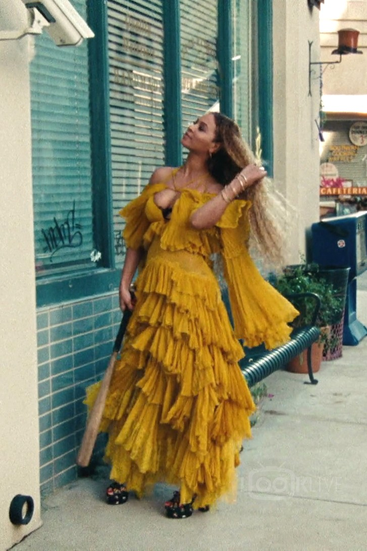 Beyonce in the famous Roberto Cavalli ruffle dress