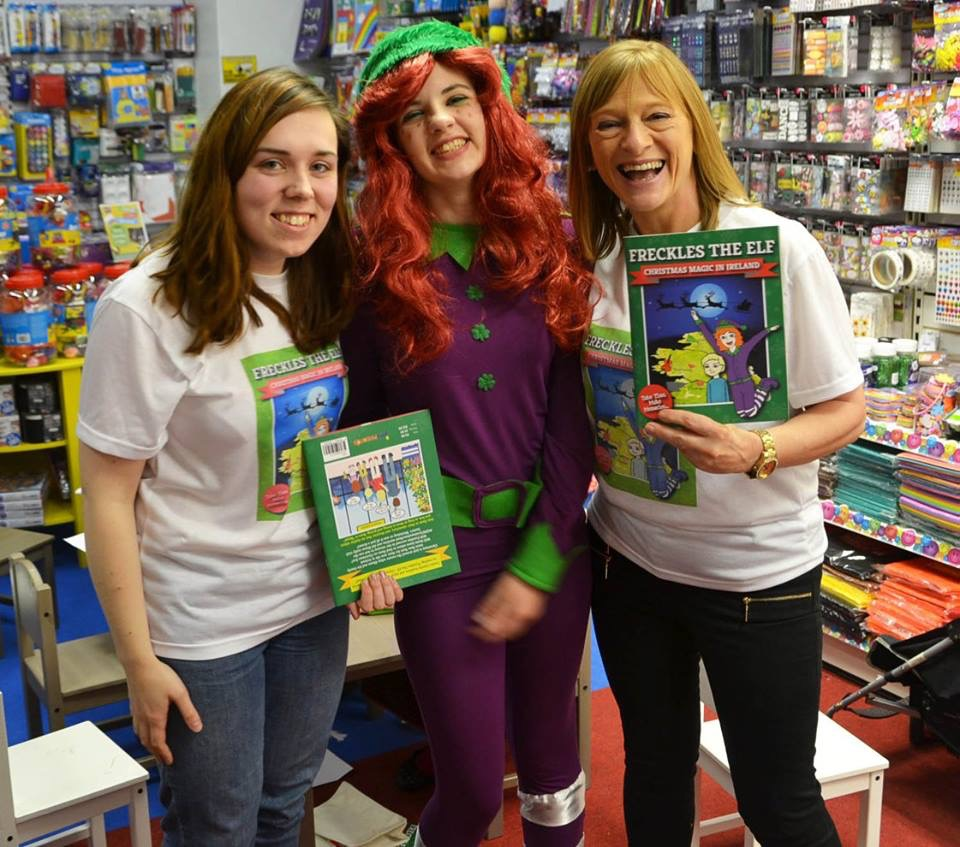 Illustrator Jenny Yourell, Freckles the Elf herself, and author Evelyn McGlynn